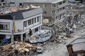 OFUNATO, Japan (March 15, 2011) - A fishing boat is noticeably out of place after being swept ashore during a massive tsunami